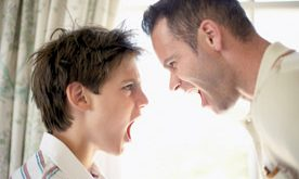 Father and Son Shouting at Each Other --- Image by © Royalty-Free/Corbis